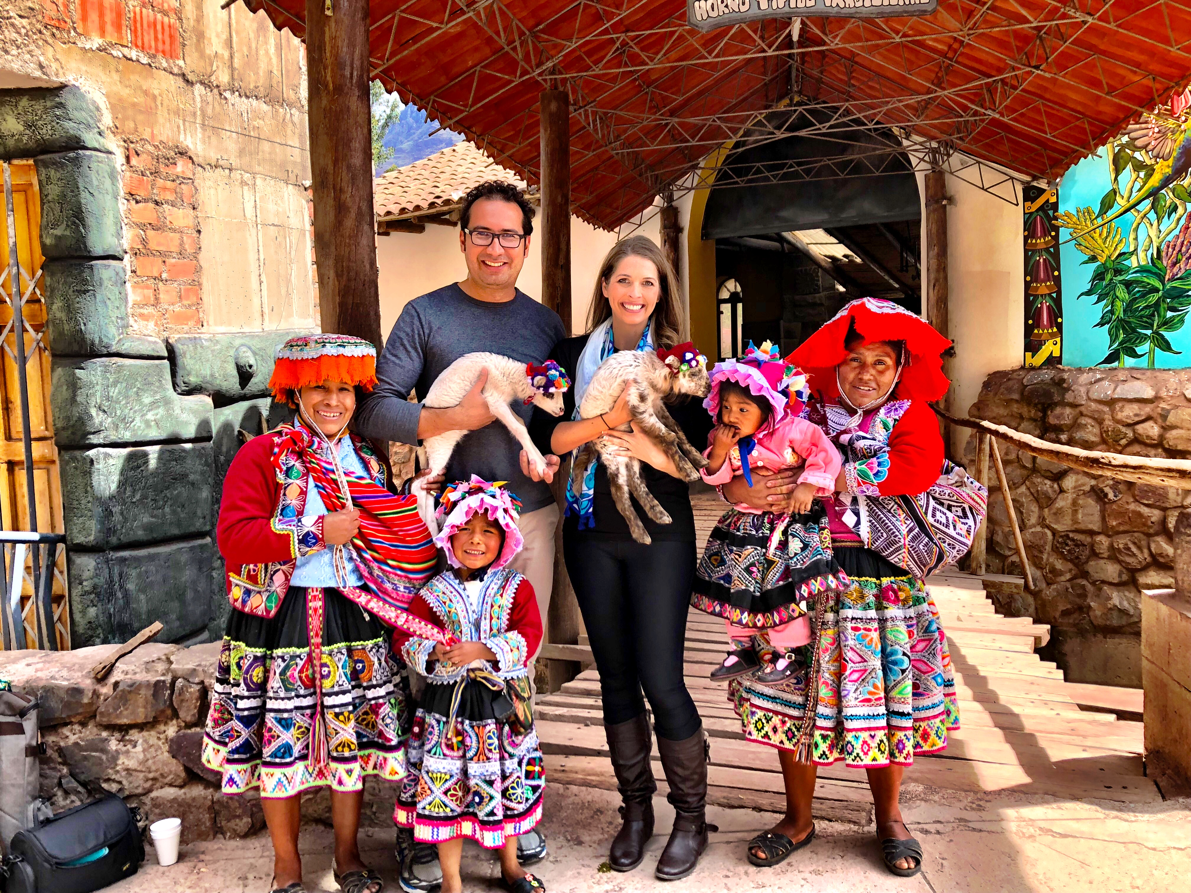 Posing with a Peruvian Family in Pisac Market