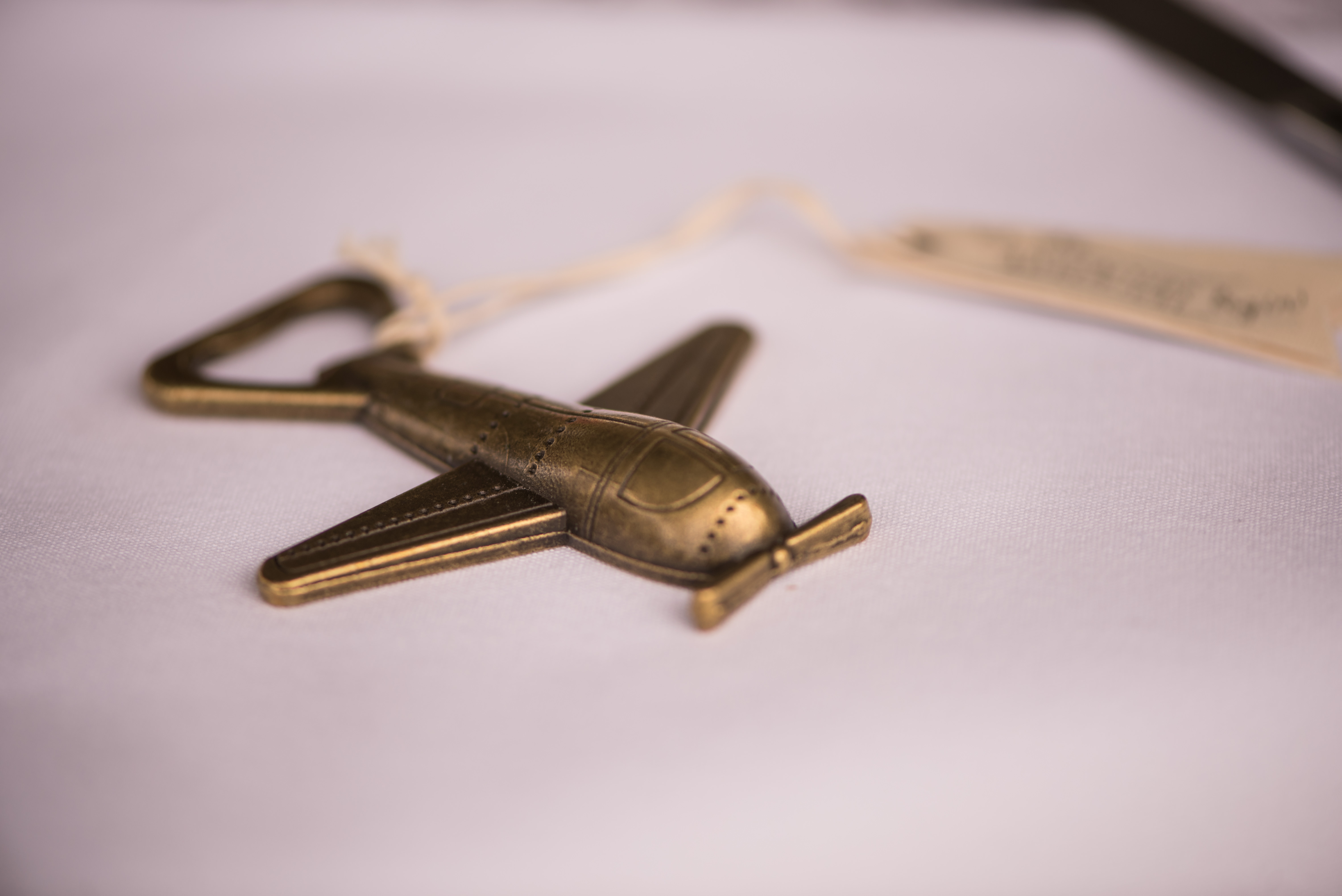 Travel-themed wedding: Airplane shaped bottle openers