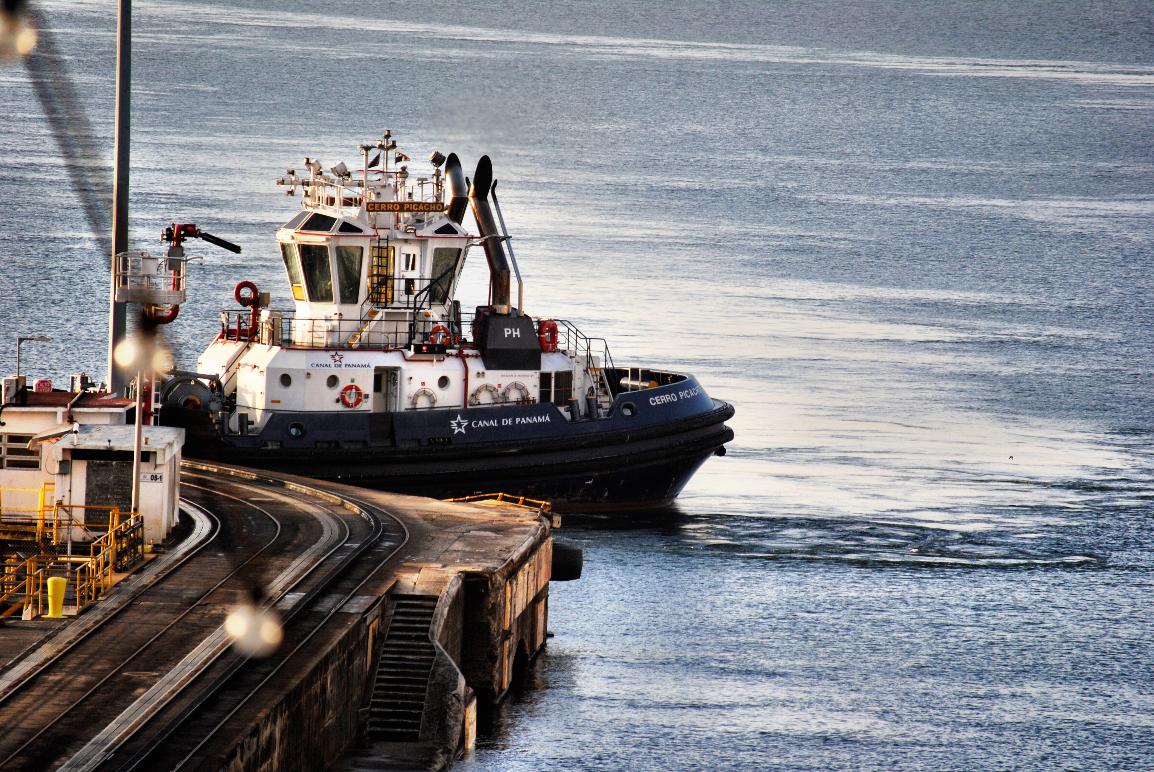 Tugboats help guide ships through the Panama Canal