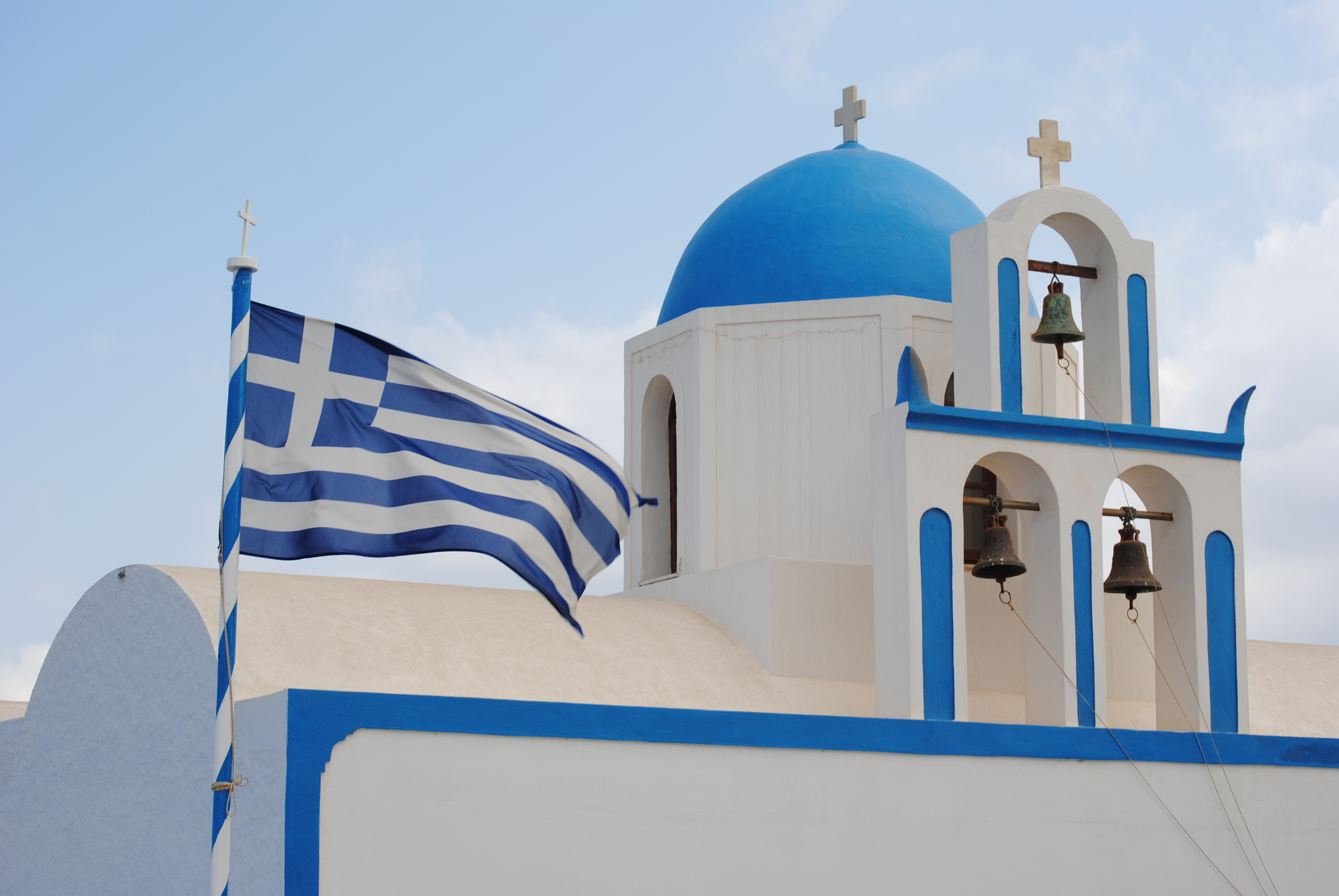 Must Do in Santorini: Snap photos of the iconic blue dome churches