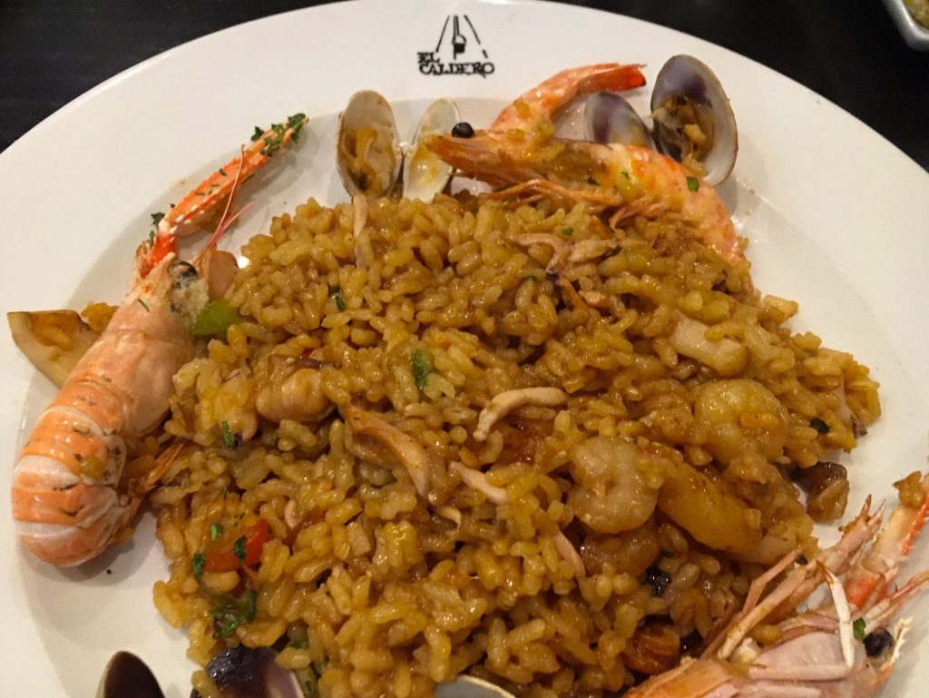 Eat paella in Spain