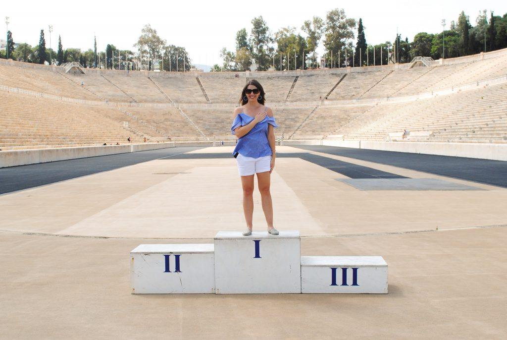 Posing on the podium at the Olympic stadium in Athens
