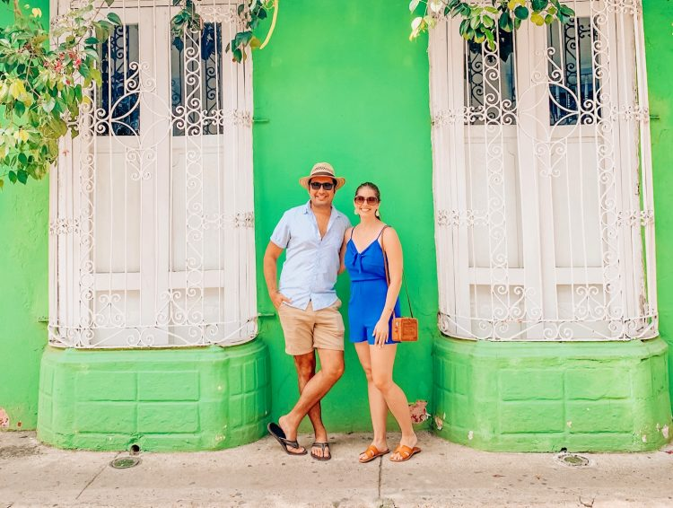 Taking photos in front of the colorful walls in Cartagena